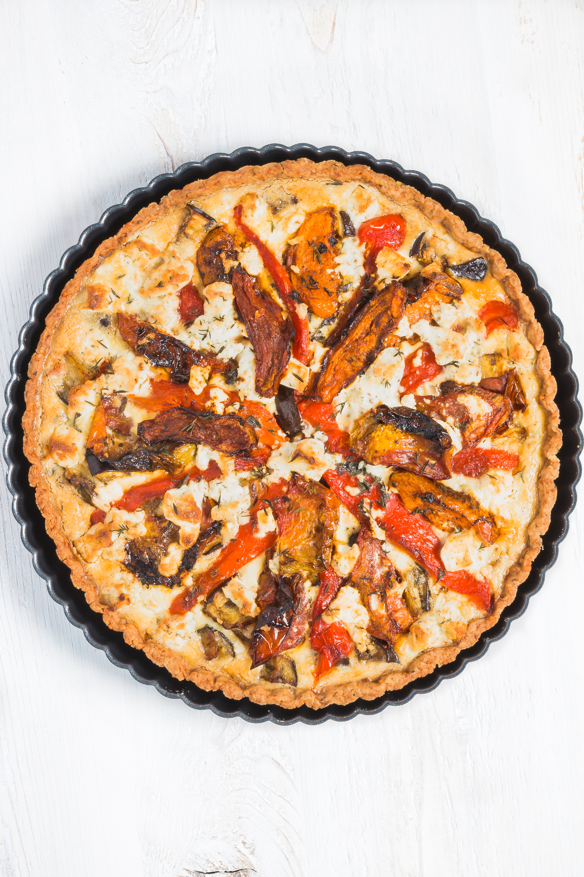 Roasted Vegetable Tart with Parmesan Crust - Celebrate summer's bounty with this Roasted Vegetable Tart with parmesan crust. It's filled with tomatoes, peppers & eggplant & can be enjoyed warm or cold. Click for RECIPE.