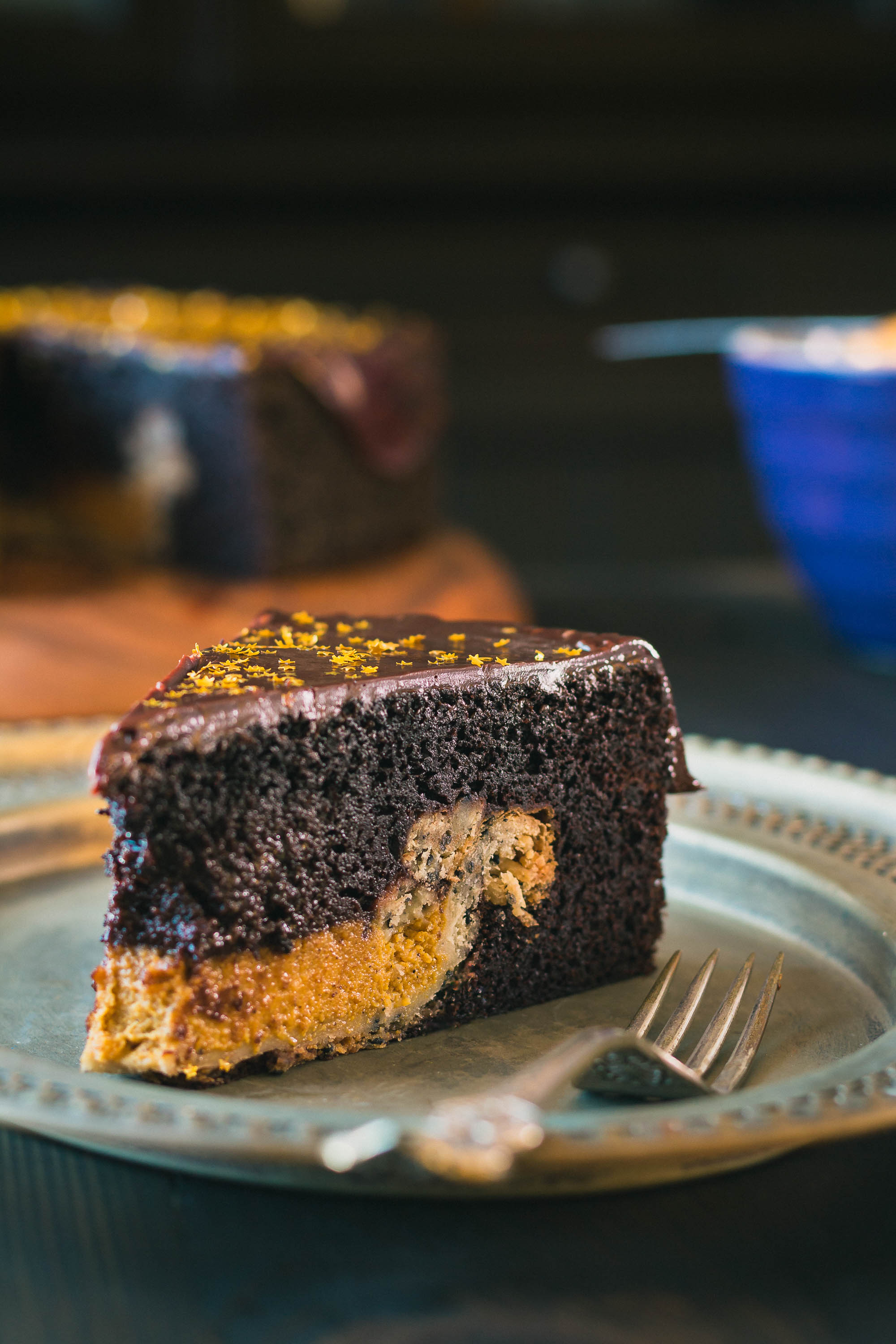 Chocolate Cake with Pumpkin Pie Surprise - Why choose between cake & pie when you can have this rich chocolate cake with a pumpkin pie inside - all smothered with a rich, chocolate ganache.