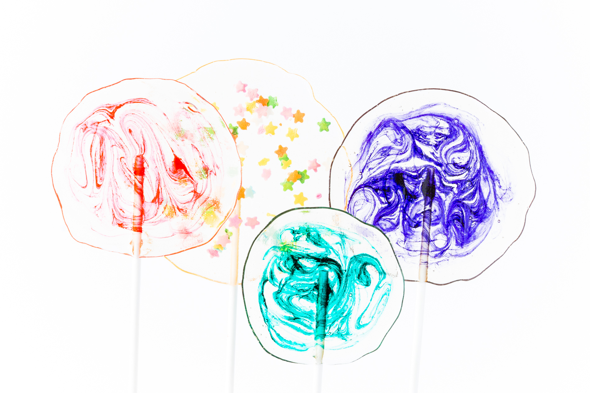 Clear Homemade Lollipops with Colorful Swirls