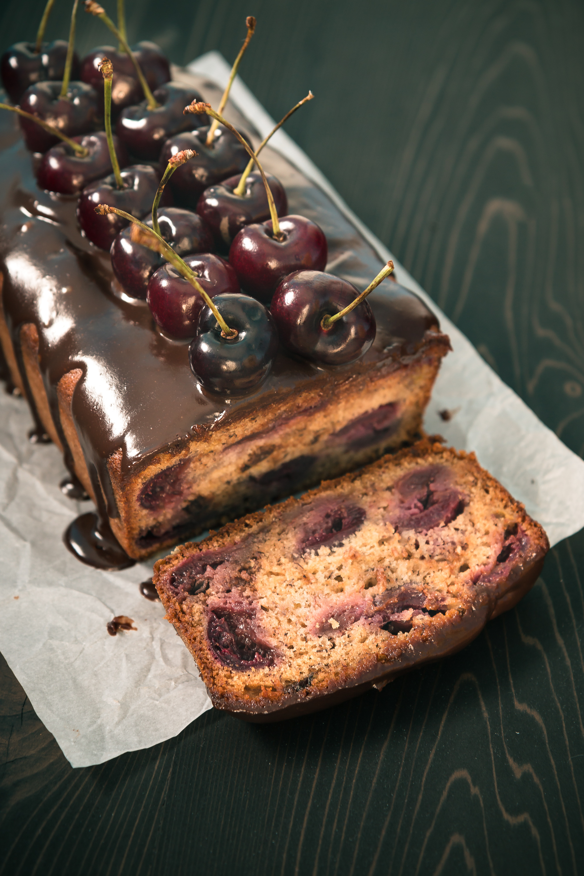 The Road to Honey's Most Popular Recipes of 2016 - Chocolate Cherry Banana Bread - This elegant Chocolate Cherry Banana Bread is moist & delicious & sure to impress with juicy cherries, bits of chocolate, & a chocolate honey glaze.