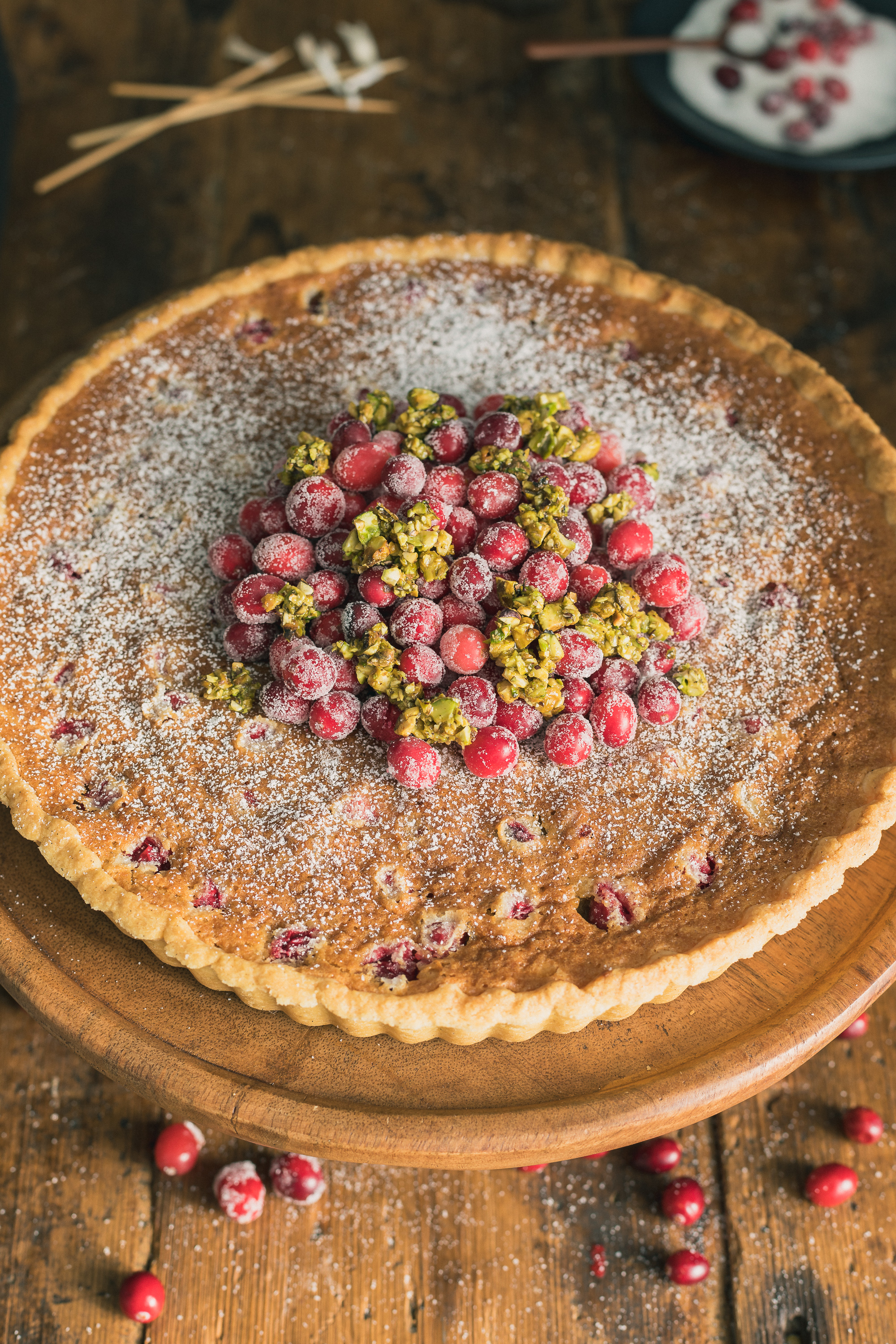 Cranberry Tart with Almond Frangipane - This French style fruit tart stars tart cranberries & a nutty almond frangipane nestled in a buttery pastry shell & topped with sugared cranberries & honeyed pistachios. It's elegant, yet easy & sure to impress at parties.