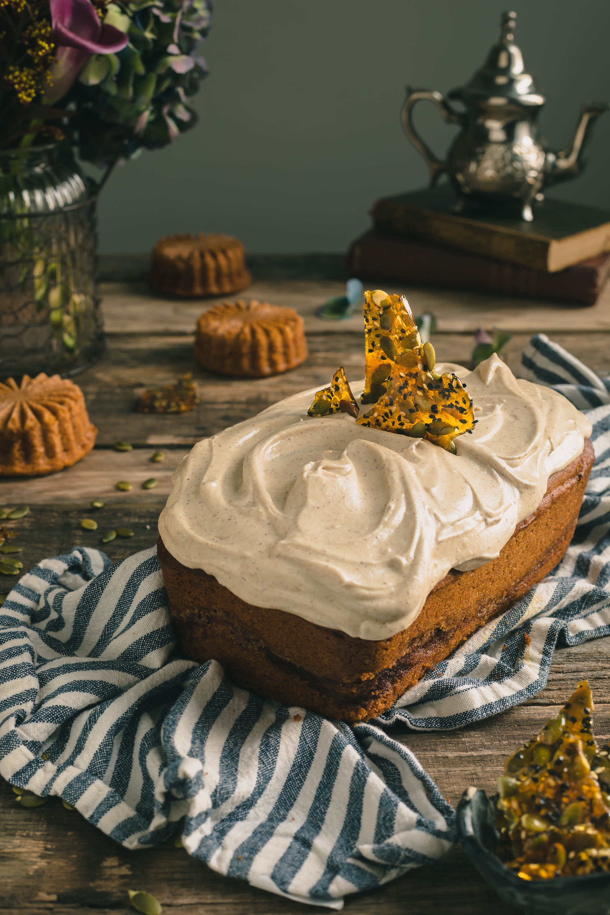 Pumpkin Bread with Maple & Brown Butter Cream Cheese Frosting - This moist & delicious pumpkin quickly bread is loaded with the warm & cozy spices that symbolize fall.  To up the decadence even more, it is topped with a thick layer of cream cheese frosting enhanced with the nuttiness of brown butter & the sweet and comforting flavor of maple syrup.  It's then crowned with sweet & crunchy pieces of Pumpkin & Sesame Seed Toffee.  The ultimate in fall baking.